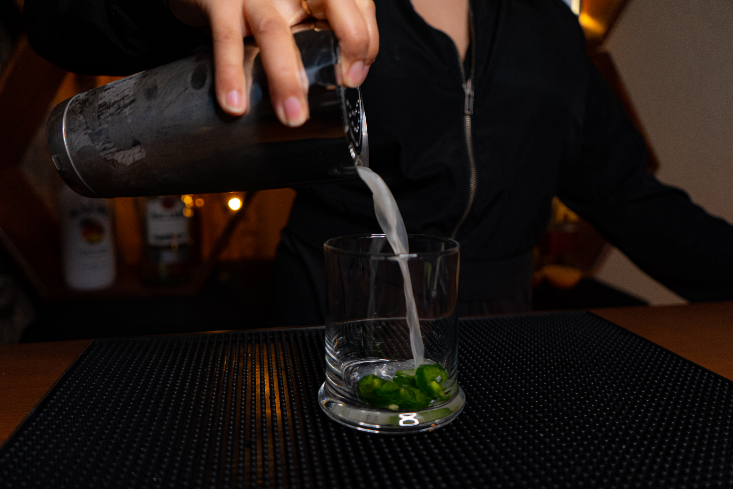 pouring a mixed cocktail through Boston Shaker